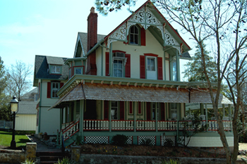 April 2006-restored to original colors with new cedar shakes on porch roof